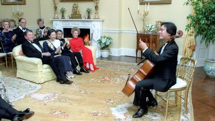 Cellist Yo-Yo Ma performs at a private dinner hosted by American President Ronald Reagan in the White House Yellow Oval Room in 1987.