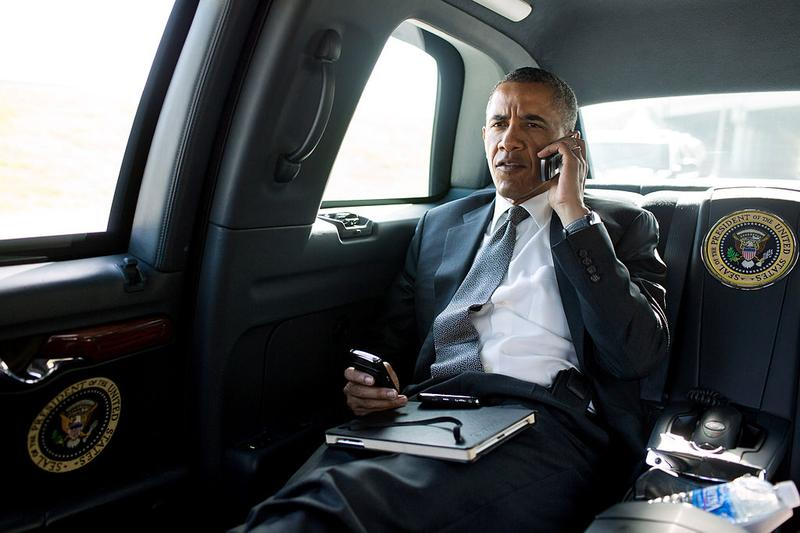 President Barack Obama talks on the phone with Aurora Mayor Steve Hogan the day of the movie theater shooting in Aurora, CO. July 20, 2012