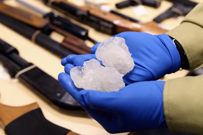 Detective Paul Baker holds two rocks of crystal meth with a street value of NZD$83,000 at the North Shore Policing Centre on August 19, 2010 in Auckland, New Zealand.