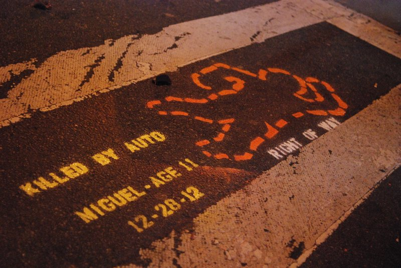 A memorial painted on a street in Queens where a pedestrian was killed