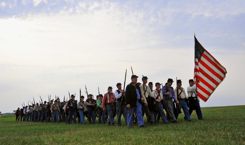 Union troops return to their encampment after battle on July 2, 2011 during re-enactments of battles during the three-day battle of Gettysburg at the Gettysburg National Military Park in Pennsylvania.