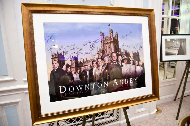 A signed and framed poster of Downton Abbey awaits auction during 'An Evening With Downton Abbey - Raising Money For Merlin - The Medical Relief Charity' at The Savoy Hotel on July 14, 2011 in London.