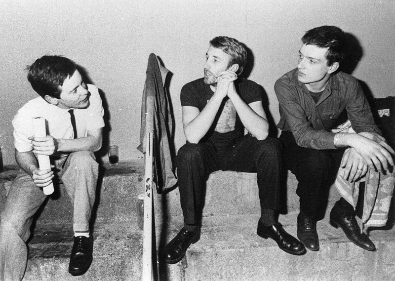 "3/4 of Joy Division. Peter Hook says ""Proof we used to get on! YMCA London, I think. Very smart! Steve has gone for cigarettes!"""