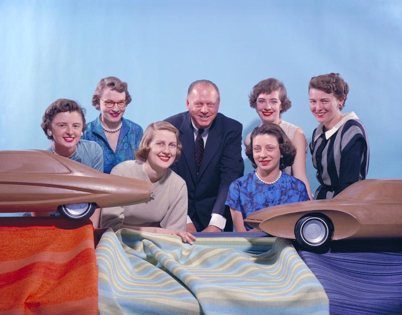 """Six of GM's """"Damsels of Design,"""" photographed circa 1955. From left: Suzanne Vanderbilt, Ruth Glennie, Marjorie Ford Pohlman, Harley Earl, Jeanette Linder, Sandra Logyear, Peggy Sauer."""