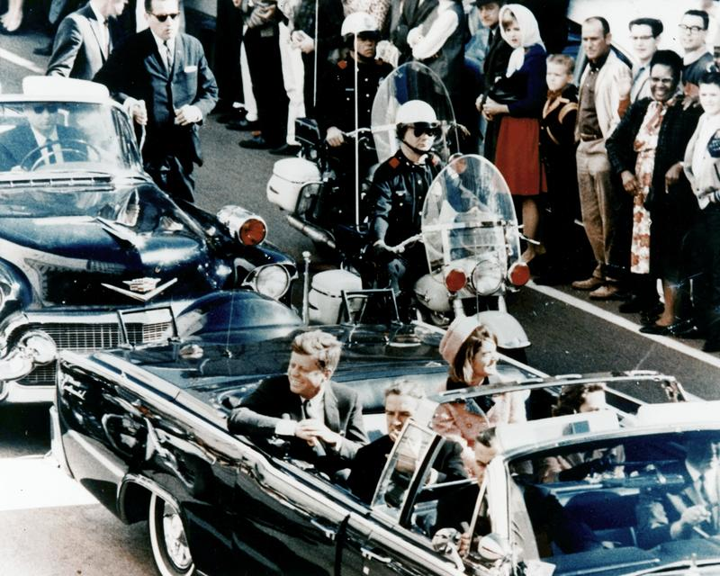 Picture of President Kennedy in the limousine in Dallas, Texas, on Main Street, minutes before the assassination. November 22, 1963