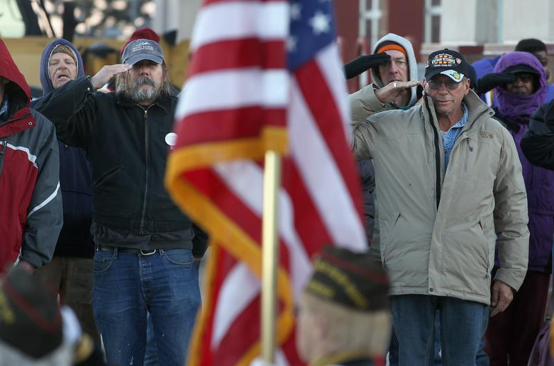 DENVER, CO:  Homeless veterans say the Pledge of Allegiance at this VA event, where they received free clothing, medical care and employment assistance, among other things. November 3, 2011.