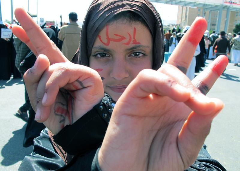 A young Yemeni with the word 'leave' written in Arabic on her forehead shows the V-sign for victory during a protest against the regime of Ali Abdullah Saleh in the capital Sanaa, on Nov. 11, 2011.