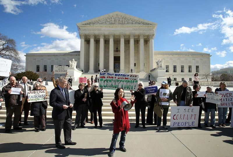Activists urge the Supreme Court to overturn Citizens United v. Federal Election Commission in 2012.