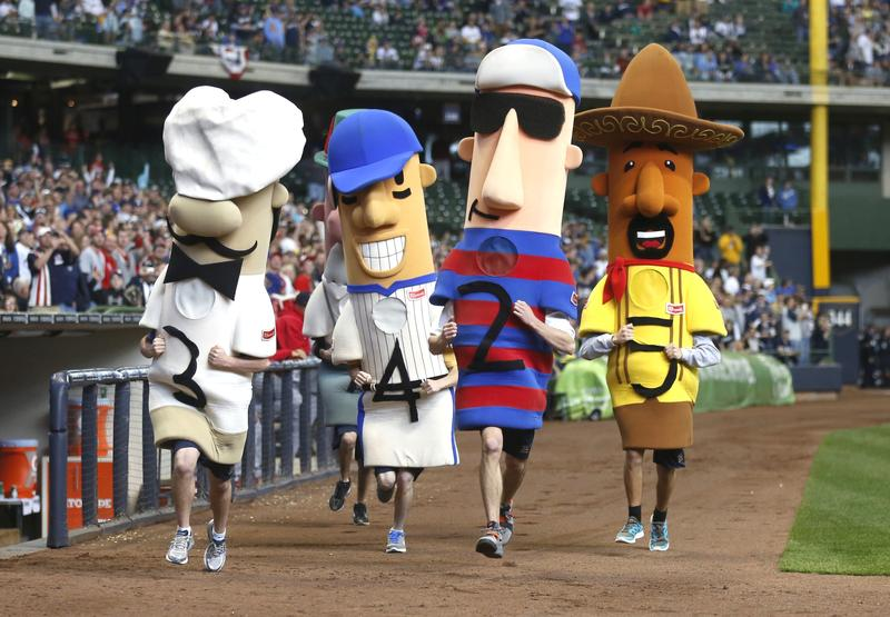 The racing sausages run around the field during the St. Louis Cardinals and Milwaukee Brewers game at Miller Park on April 8, 2012 in Milwaukee, Wisconsin.