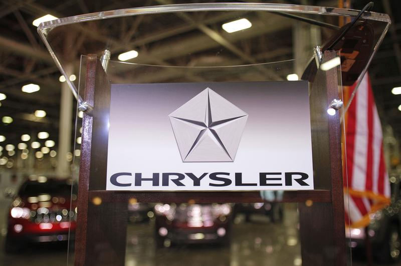 The Chrysler Group logo is attached to a podium at Chrysler's Jefferson North Assembly Plant where former Polish President and Nobel Peace Prize winner Lech Walesa will speak April 26, 2012 in Detroit