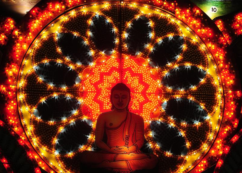 A lit display featuring a seated Buddha is pictured during the annual Buddhist festival of Vesak in Colombo on May 5, 2012.