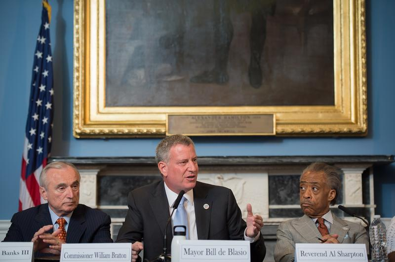 Mayor Bill de Blasio hosts a roundtable on police-community relations with Commissioner Bill Bratton, Reverend Al Sharpton, and others in City Hall's Blue Room, in C