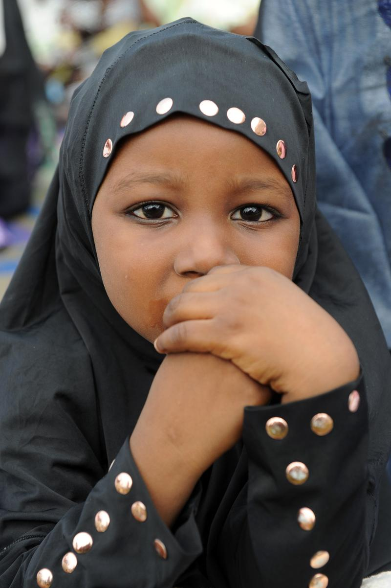 A young girl prays on the first day of Eid al-Fitr at Obalende praying ground in Lagos, Nigeria on August 19, 2012.