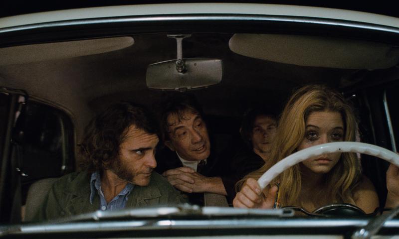 Joaquin Phoenix, Martin Short, Jordan Christian Hearn and Sasha Pieterse in <em>Inherent Vice</em>