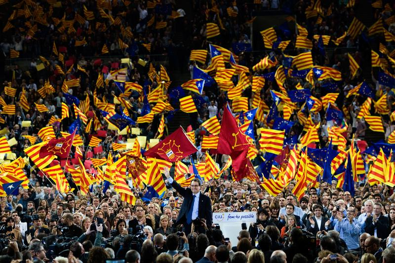 Artur Mas waves to supporters during the closing rally ahead of the Catalan Elections, at the Palau Sant Jordi on November 23, 2012 in Barcelona, Spain.