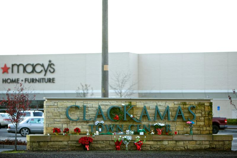 Flowers and candles sit outside the Clackamas Town Center mall on December 13, 2012 in Clackamas, Oregon.