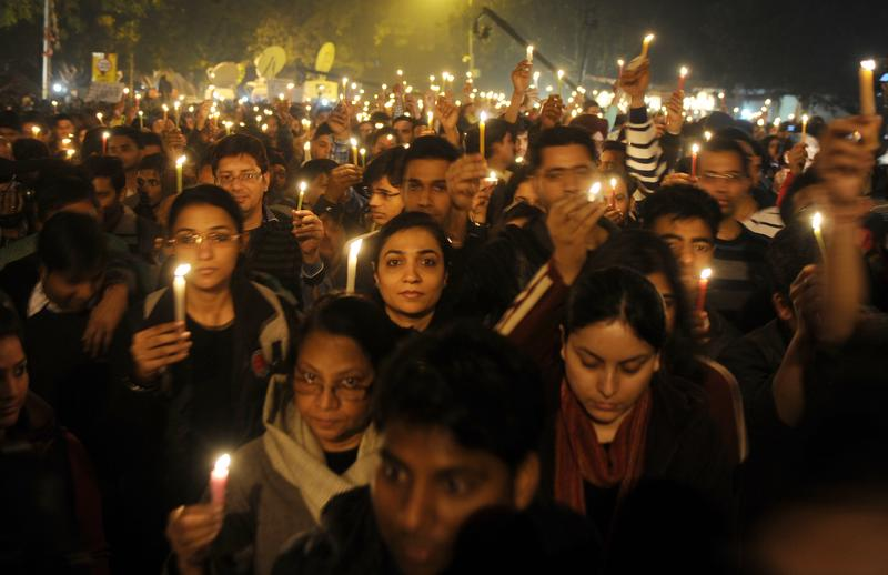 Indian protesters hold candles during a rally in New Delhi late December 29,2012, after the death of a gang rape victim from the Indian capital.