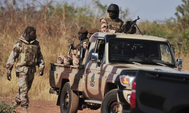 Malian National guards patrol on January 16, 2013 at a military airbase in Bamako.