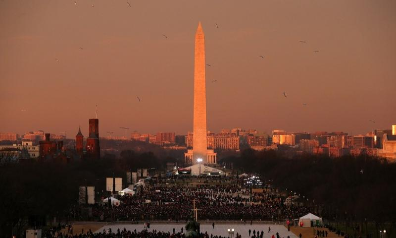 Birds fly over the mall in the early morning in front of the Washington Monument before the presidential inauguration at the U.S. Capitol on January 21, 2013 in Washington, D.C.