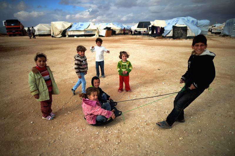 Children play in a Syrian refugee camp in Mafraq, Jordan