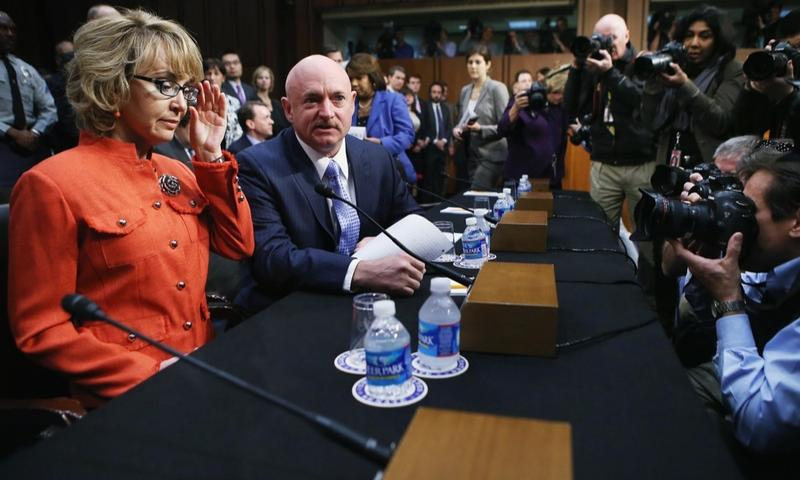 Shooting victim and former U.S. representative Gabby Giffords arrives for a Senate Judiciary Committee hearing about gun control on January 30, 2013.