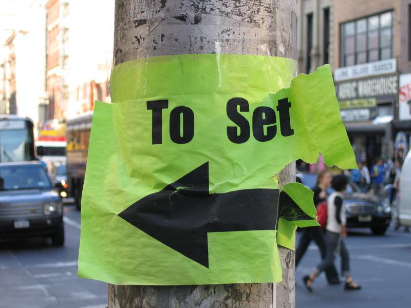 Sign pointing to Law & Order SVU filming in downtown Manhattan.