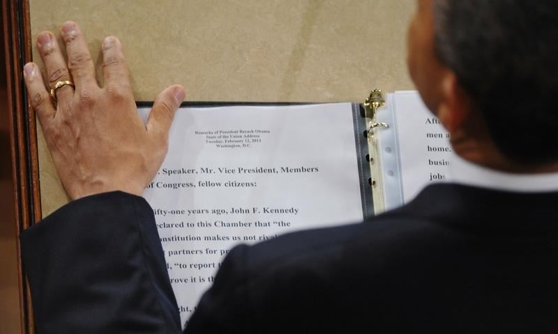 President Barack Obama rests his hand next to a copy of his speech as he delivers his State of the Union address.