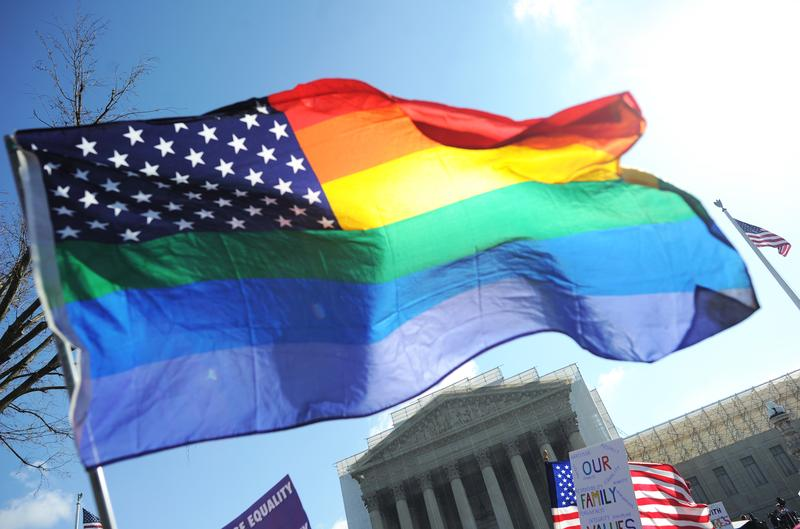 Same-sex marriage supporters wave a rainbow flag in front of the US Supreme Court on March 26, 2013 in Washington, DC.