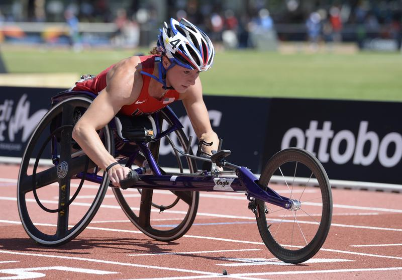 Russian-born US athlete Tatyana McFadden crosses the finish line and wins the Women's 200m T54 final on July 21, 2013 during the IPC Athletics World Championships of Lyon at the Rhone Stadium.