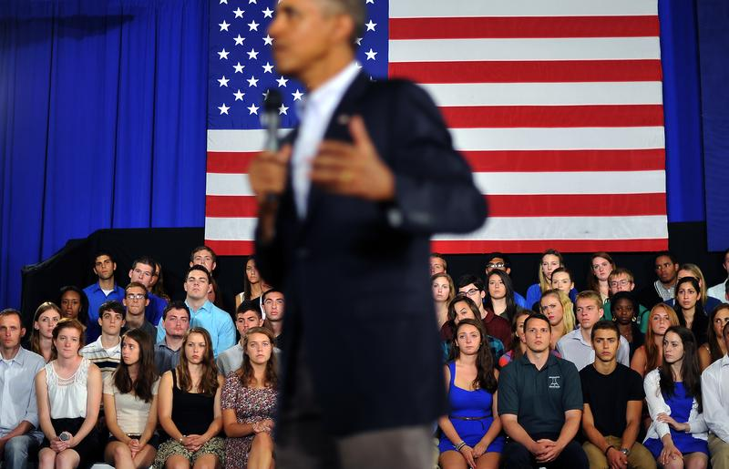 US President Barack Obama answers a question during a town hall meeting at Binghamton University, on August 23, 2013 in Binghamton, New York.