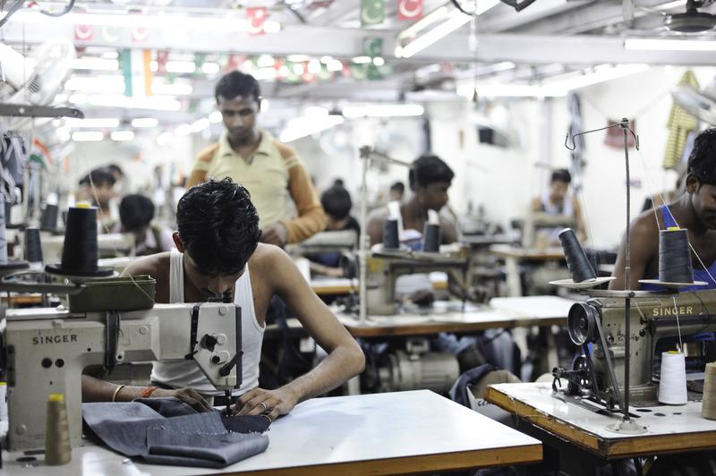 Inside a sweatshop in Dharavi Slum in Mumbai workers produce jeans for the western market.