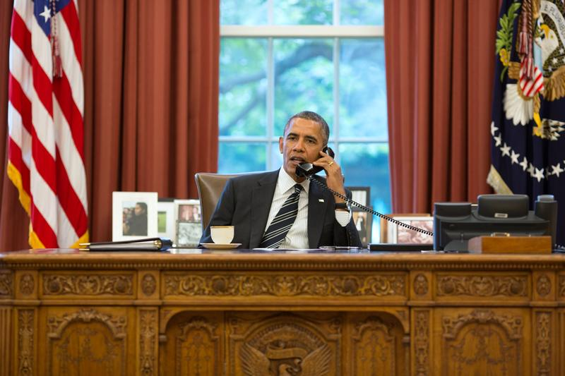 President Barack Obama speaks with President Hassan Rouhani of Iran during a phone call in the Oval Office September 27, 2013 in Washington D.C.