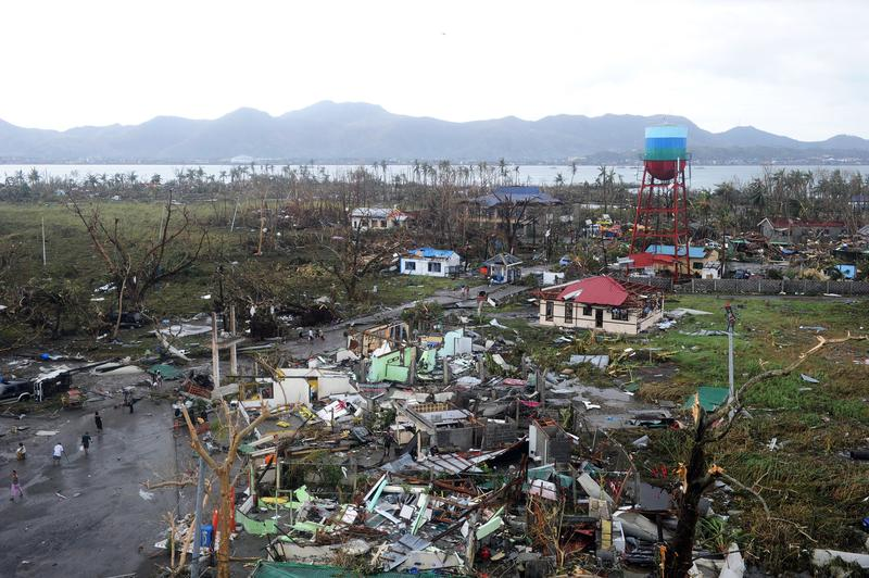 A general shot shows houses destroyed by the strong winds caused by typhoon Haiyan at Tacloban, eastern island of Leyte on November 9, 2013.