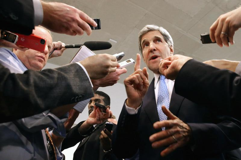U.S. Secretary of State John Kerry speaks with reporters at the U.S. Capitol. Kerry is asking Congress not to approve any new sanctions on Iran while negotiations continue with Tehran