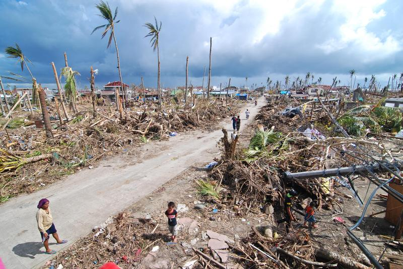 Affected residents survey the damage in Tacloban City on November 14, 2013 in Tacloban, Philippines.