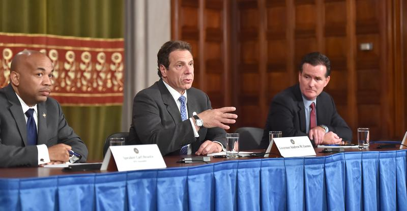 Governor Andrew M. Cuomo (center), Assembly speaker Carl Heastie (l) and Senate Majority leader John Flanagan announce the end of the New York State Legislative Session.