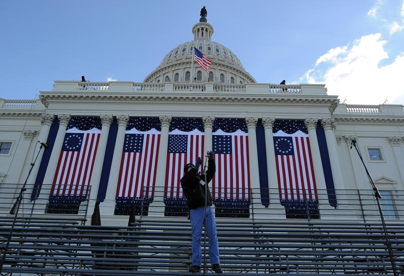 A worker sets up microphones at the US Capitol as preparations continue for the second inauguration of US President Barack Obama.