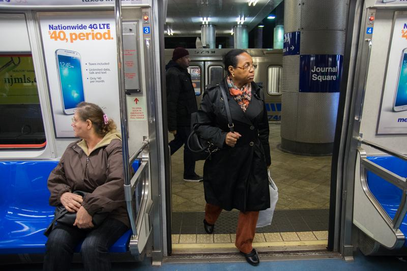 Commuters board a PATH train toward Newark at the Journal Square station in New Jersey.