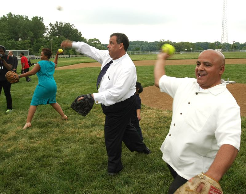 Gov. Christie plays catch with Camden kids alongside Camden Mayor Dana Redd and Council President Frank Moran, both Democrats.
