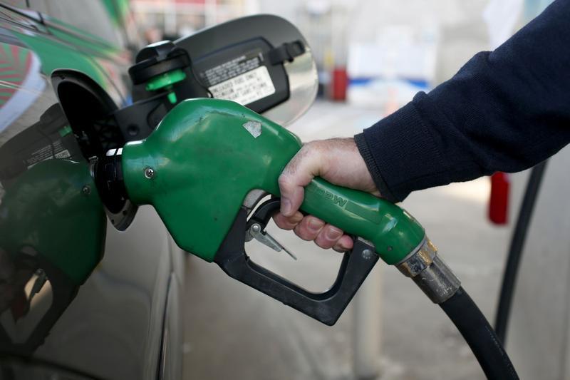 A driver fills his gas tank
