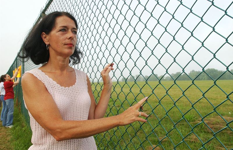 Lois Gibbs, a former resident and community leader, looks at Love Canal during a commemoration of the 25th Anniversary of the toxic waste landfill August 1, 2003 in Niagara Falls, New York.