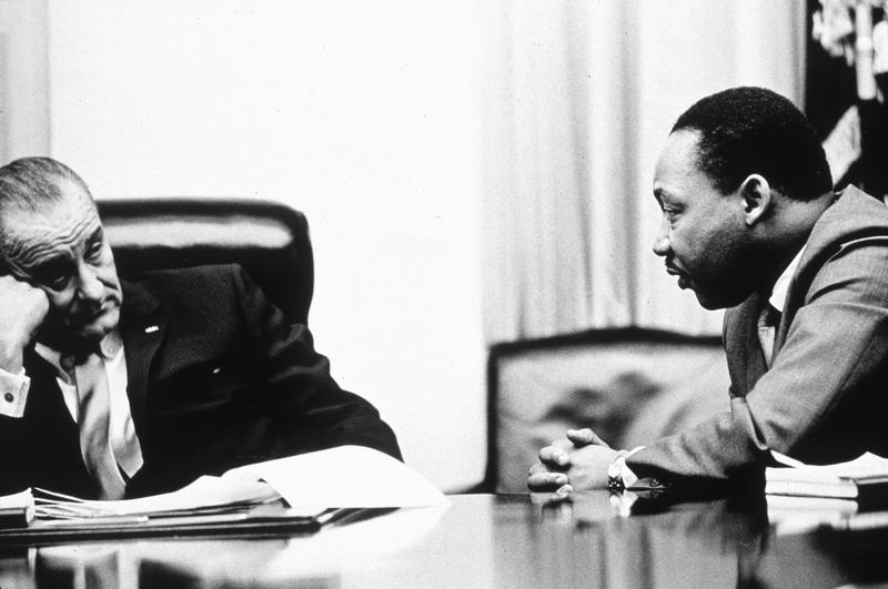 In this undated photo, President Lyndon B Johnson discusses the Voting Rights Act with civil rights campaigner Martin Luther King Jr.
