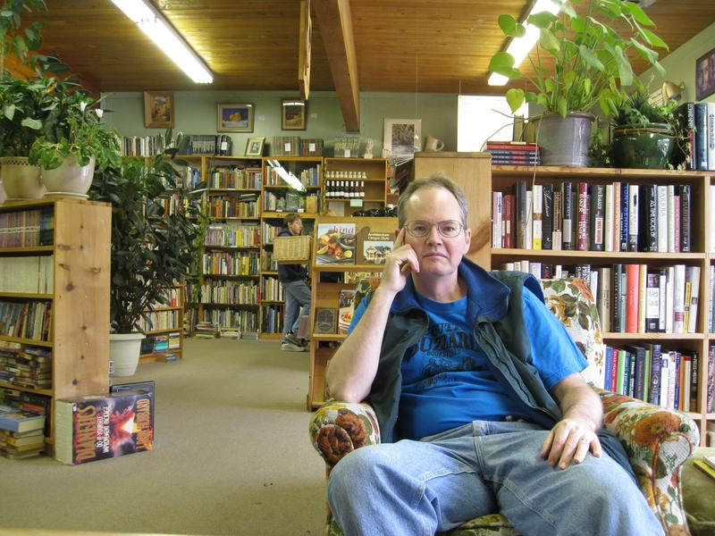 A man at community book store While Away Books in Roseburg, Oregon.