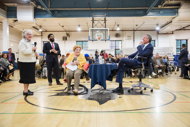 New York State Senator Toby Ann Stavisky says a few words to New York City Mayor Bill de Blasio and Council Member Karen Koslowitz during a town hall meeting with residents in Council district 29.