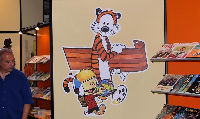 "A painting on the wall of a comic book shop of ""Calvin and Hobbes."""