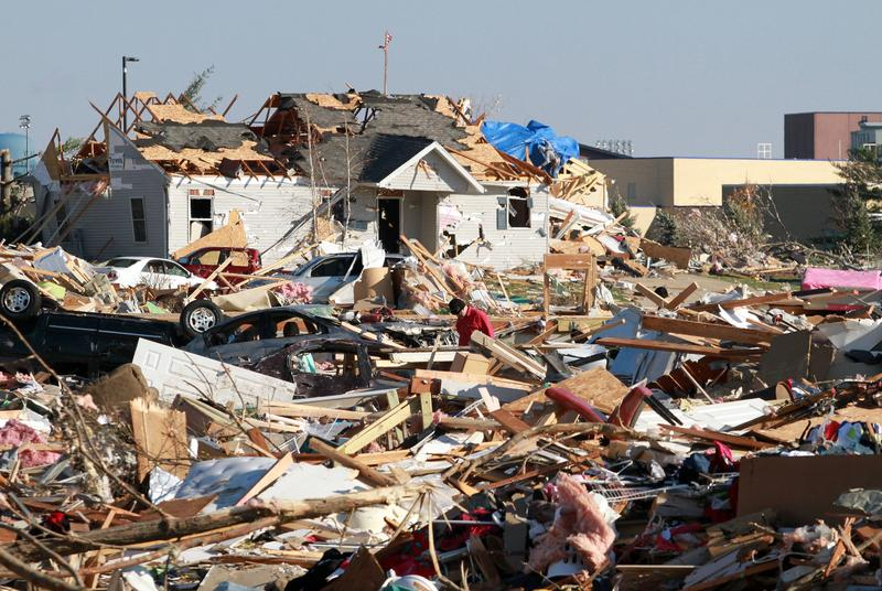 People survey the damage in the Washington Estates sudivision in the aftermath of a tornado on November 18, 2013 in Washington, Illinois.