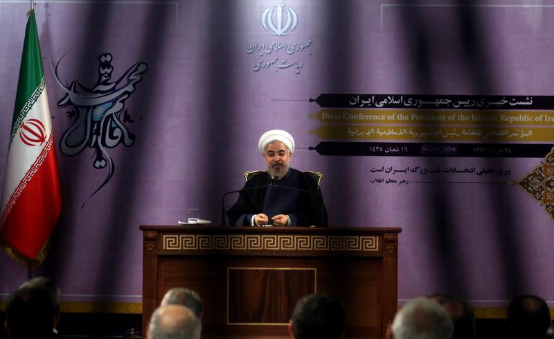 Iranian President Hassan Rouhani speaks during a press conference in Tehran on June 14, 2014. Iran may consider cooperating with the United States in fighting Sunni extremist fighters in Iraq.