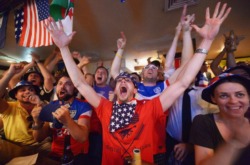 Soccer fans cheer for team U.S.A. as they face Ghana during the World Cup in Brazil at Jack Demsey's bar on June 16, 2014 in New York City.