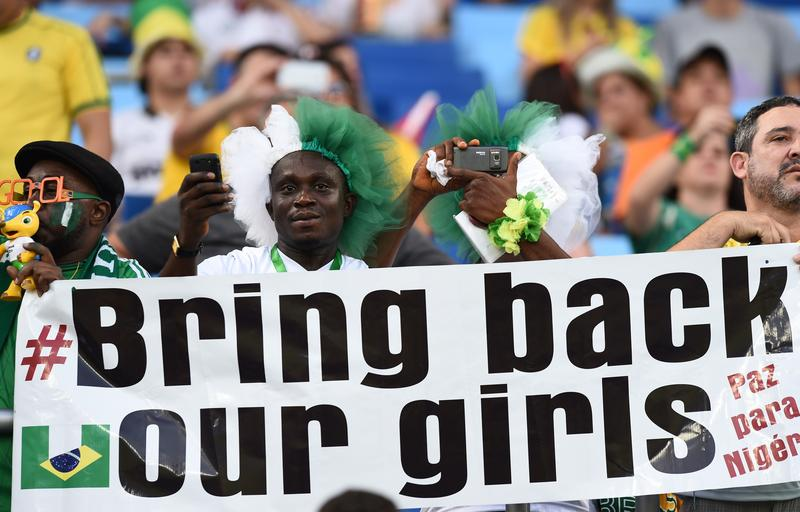 Nigeria's fans hold a banner reading 'Bring back our girls' before the Group F football match between Nigeria and Bosnia-Hercegovina at the Pantanal Arena in Cuiaba during the 2014 FIFA World Cup.