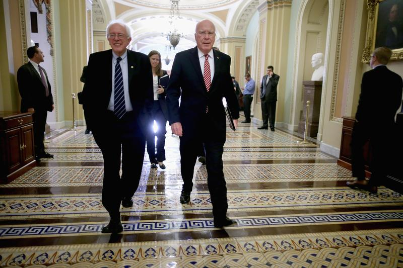 Senate Judiciary Committee Chairman Patrick Leahy (D-VT) (R) and Sen. Bernie Sanders (I-VT) walks through the halls of the U.S. Capitol November 21, 2013 in Washington, DC.